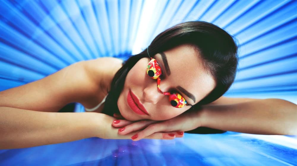 Feature | woman wearing a tanning eyeglasses | Why Wearing Tanning Salon Glasses Is Important | high quality tanning goggles